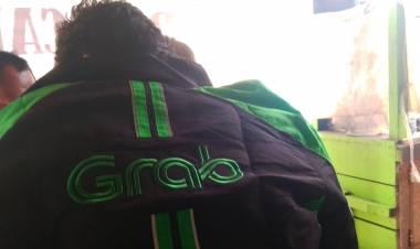 Luncurkan Program VVIP di Tangerang, Grab dan Gojek 'Akur' di Handphone Ojol
